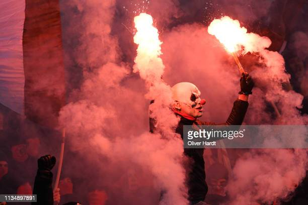 Fan of Sankt Pauli with pyrotechnics during the Second Bundesliga match between FC St Pauli and Hamburger SV at Millerntor Stadium on March 10 2019...