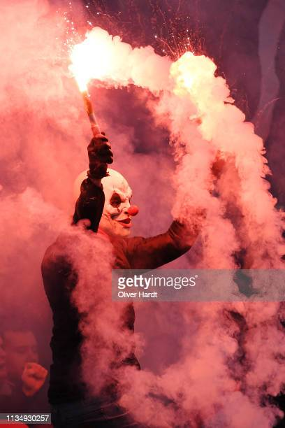 Fan of Sankt Pauli with pyrotechnics during the Second Bundesliga match between FC St. Pauli and Hamburger SV at Millerntor Stadium on March 10, 2019...