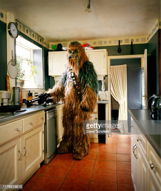 A fan of science fiction movies Star Wars is photographed at their home dressed as Chewbaca taken from a series which looks at how ordinary people...