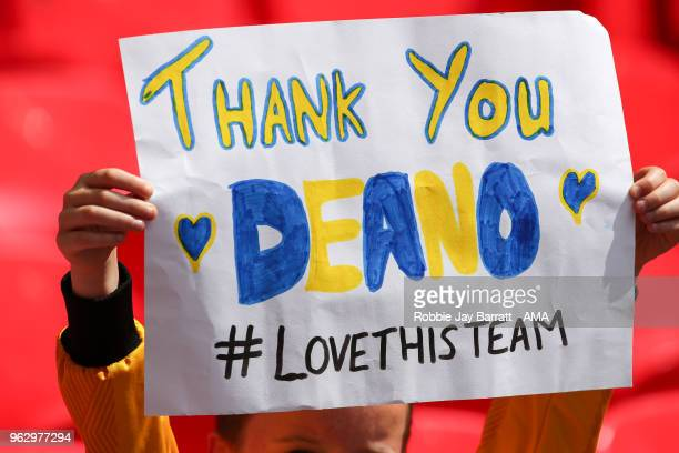 A fan of Shrewsbury Town holds up a sign for Dean Henderson of Shrewsbury Town during the Sky Bet League One Play Off Final between Rotherham United...