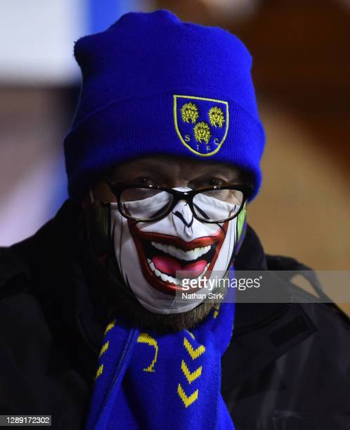Fan of Shrewsbury Town is seen wearing a mask inside of the stadium during the Sky Bet League One match between Shrewsbury Town and Accrington...