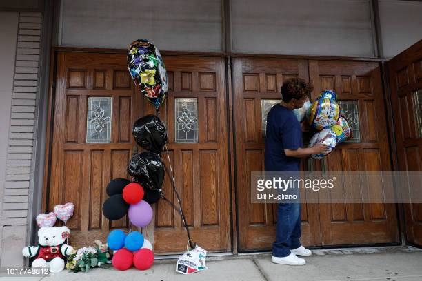 A fan of singer Aretha Franklin the 'Queen of Soul' leaves a memento at the door of New Bethel Baptist Church where Franklins' father was pastor to...