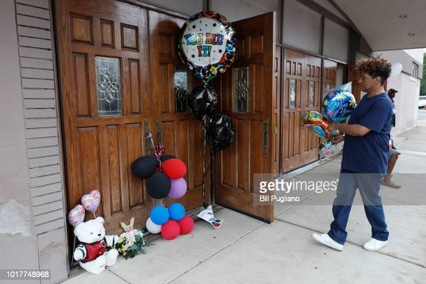 A fan of singer Aretha Franklin the 'Queen of Soul' leaves a memento at the door of New Bethel Baptist Church where Franklin's father was pastor to...