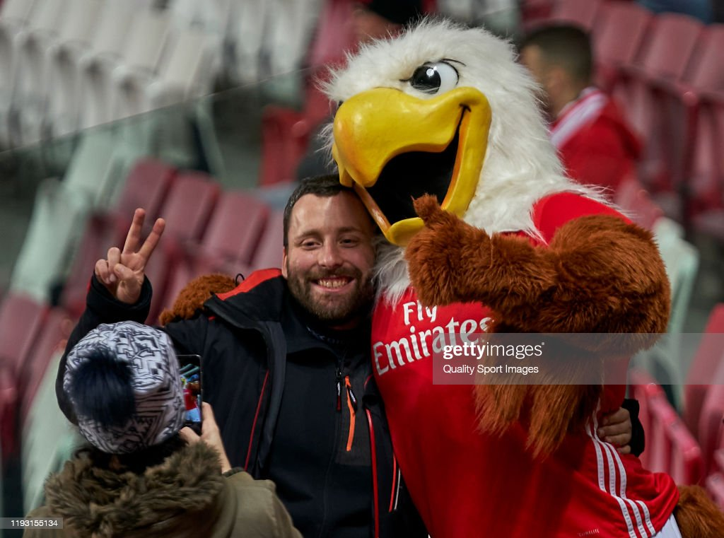 A Fan Of Sl Benfica Takes A Picture With The Team Mascot Before The News Photo Getty Images