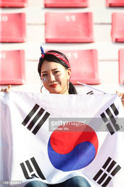 A fan of South Korea enjoys the atmosphere during the AFC Asian Cup round of 16 match between South Korea and Bahrain at Rashid Stadium on January 22...