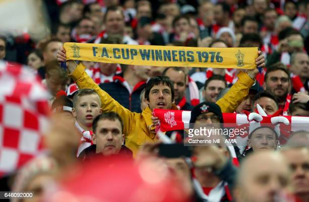 A fan of Southampton with a FA Cup winners 1976 scarf during the EFL Cup Final match between Manchester United and Southampton at Wembley Stadium on...