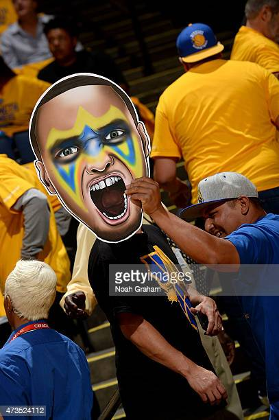 A fan of Stephen Curry of the Golden State Warriors holds a sign during a game against the Memphis Grizzlies in Game Five of the Western Conference...