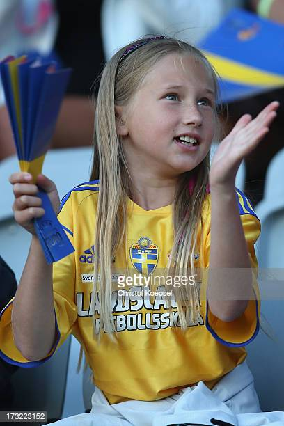 A fan of Sweden applauds her team prior to the UEFA Women's EURO 2013 Group A match between Sweden and Denmark at Gamla Ullevi Stadium on July 10...