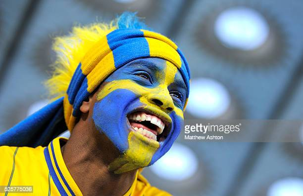 A fan of Sweden with a painted face