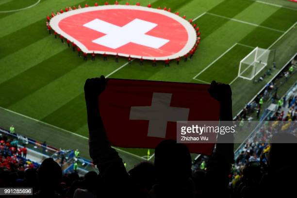 Fan of Switzerland show his flag during the 2018 FIFA World Cup Russia Round of 16 match between 1st Group F and 2nd Group E at Saint Petersburg...
