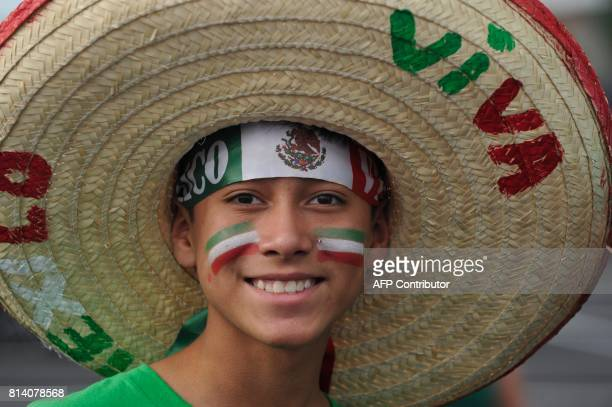A fan of team Mexico poses for a portrait before the start of the the Mexico vs Jamaica CONCACAF Group C Gold Cup soccer game on July 13 2017 at...