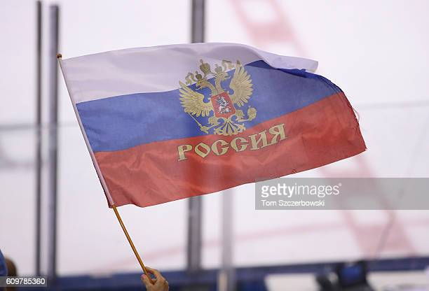 A fan of Team Russia waves a Russian flag against Team Finland during the World Cup of Hockey tournament at the Air Canada Centre on September 22...
