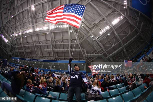 A fan of team United States waves an American flag during the game against team Czech Republic during the Men's Playoffs Quarterfinals on day twelve...