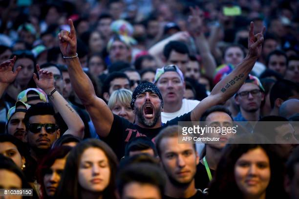A fan of the British band The Cult shouts during the band's concert at the 11th Alive Festival in Oeiras near Lisbon on July 7 2017 / AFP PHOTO /...
