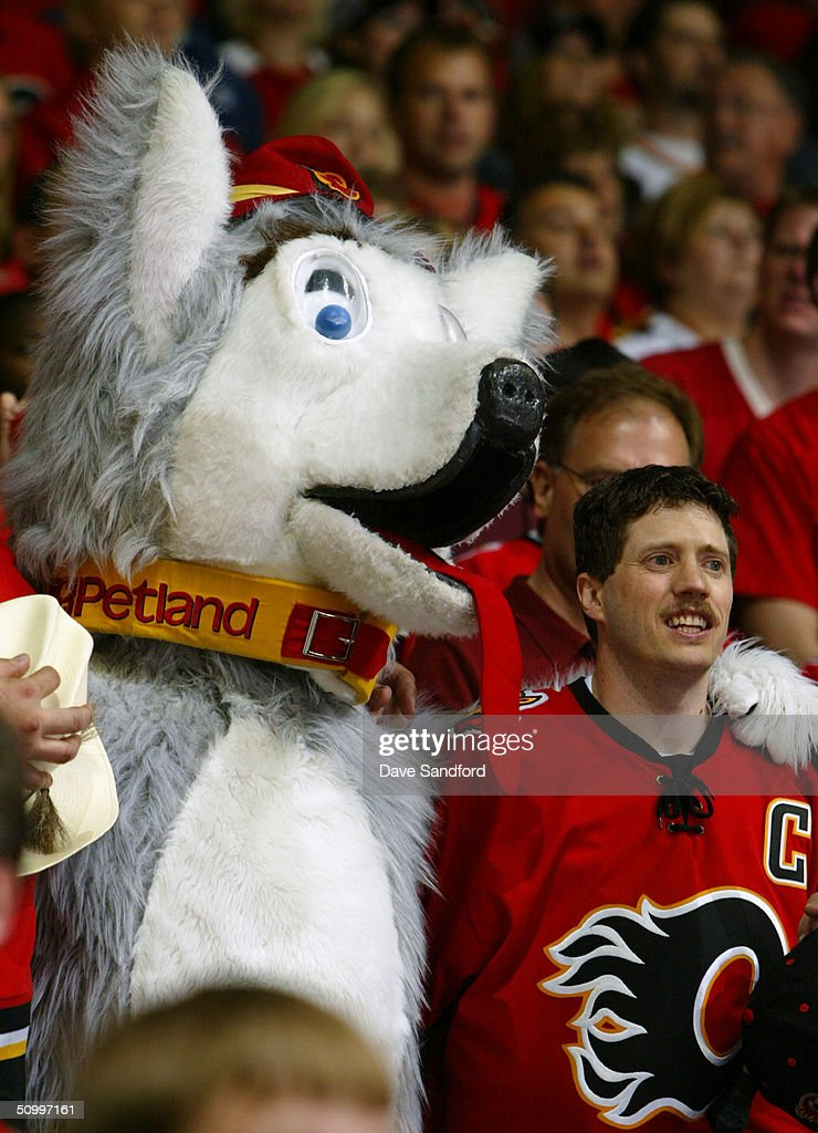 A fan of the Calgary Flames and a mascot look on as the Flames host the Tampa Bay Lightning in Game Four of the NHL Stanley Cup Finals on May 31, 2004 at the Pengrowth Saddledome in Calgary, Canada. The Lightning defeated the Flames 1-0.