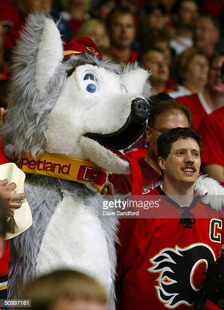 A fan of the Calgary Flames and a mascot look on as the Flames host the Tampa Bay Lightning in Game Four of the NHL Stanley Cup Finals on May 31 2004...