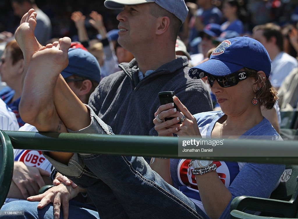 A fan of the Chicago Cubs uses her hand-held device during a game between the Cubs and the Cincinnati Reds at Wrigley Field on May 8, 2011 in Chicago, Illinois. The Reds defeated the Cubs 2-0.