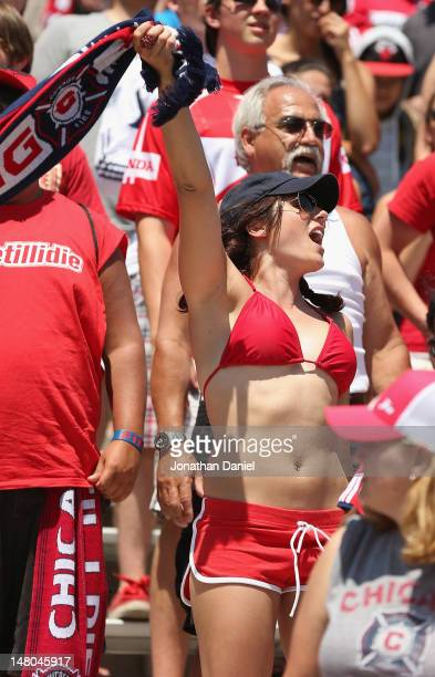 A fan of the Chicago Fire cheers as the Fire take on the Los Angeles Galaxy during an MLS match at Toyota Park on July 8 2012 in Bridgeview Illinois