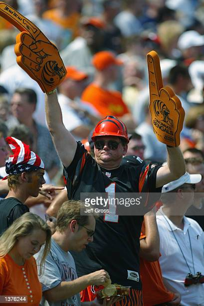 A fan of the Cincinnati Bengals holds up two foam fingers during the NFL game against the San Diego Chargers on September 8 2002 at Paul Brown...
