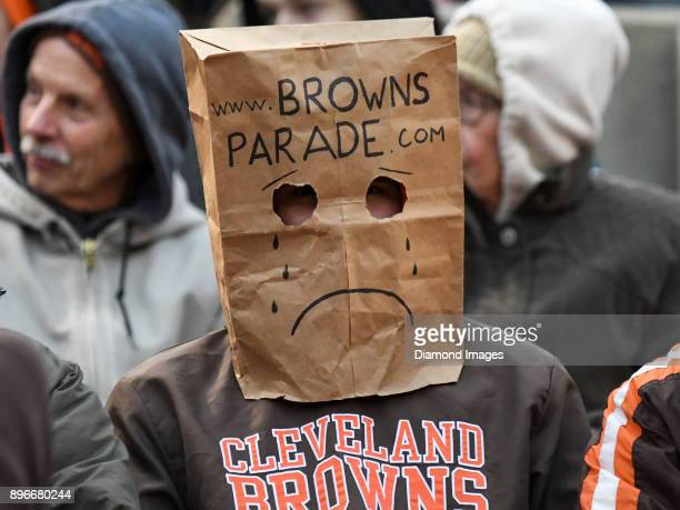 A fan of the Cleveland Browns watches the action from his seat as he wears a paper bag on his head in the fourth quarter of a game on December 17...