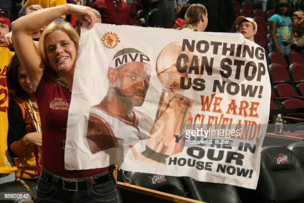 A fan of the Cleveland Cavaliers holds a poster featuring LeBron James during a game against the Boston Celtics on April 12 2009 at the Quicken Loans...
