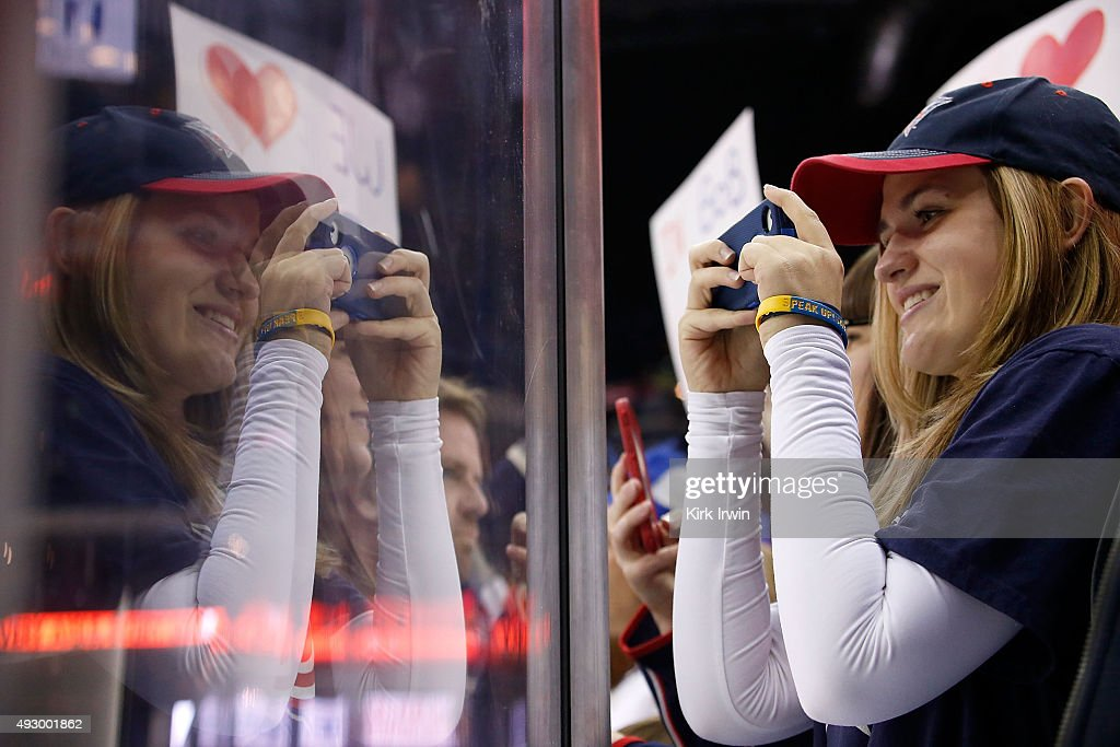 A fan of the Columbus Blue Jackets takes pictures with her phone during pregame warmups prior to the start of the game between the Columbus Blue Jackets and the Toronto Maple Leafs on October 16, 2015 at Nationwide Arena in Columbus, Ohio.