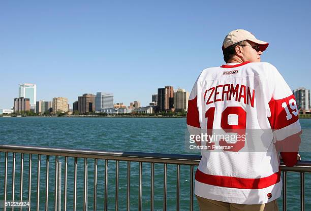 A fan of the Detroit Red Wings wearing a Steve Yzerman jersey sits on the riverfront before game one of the 2008 NHL Stanley Cup Finals against the...