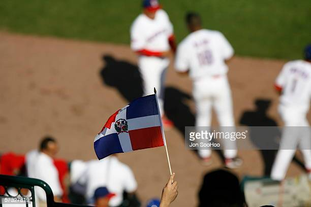 A fan of the Dominican Republic holds up a flag during the game against Italy at Disney's Wide World of Sports Complex in Kissimmee Florida on March...
