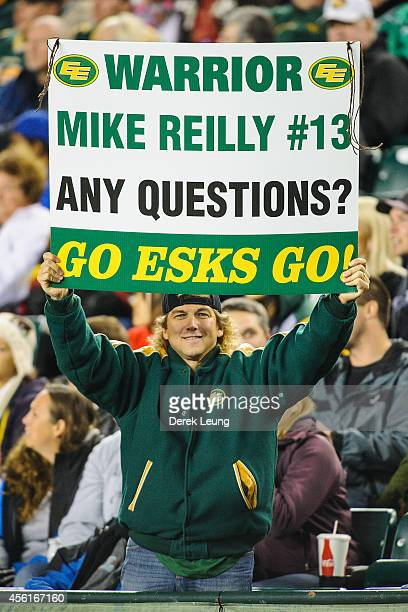 Fan of the Edmonton Eskimos cheers on Mike Reilly during a CFL game at Commonwealth Stadium on September 26, 2014 in Edmonton, Alberta, Canada.