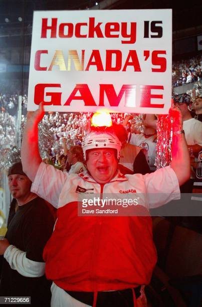 A fan of the Edmonton Oilers cheers against the Carolina Hurricanes during game six of the 2006 NHL Stanley Cup Finals on June 17 2006 at Rexall...