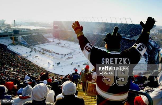 A fan of the Edmonton Oilers cheers as his teams faces the Montreal Canadiens during the Molson Canadien Heritage Classic Megastars Game on November...