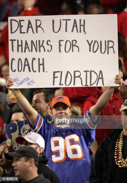 Fan of the Florida Gators holds up a sign showing his appreciation for Head coach Urban Meyer of the Utah Utes becoming the new head coach of Florida...