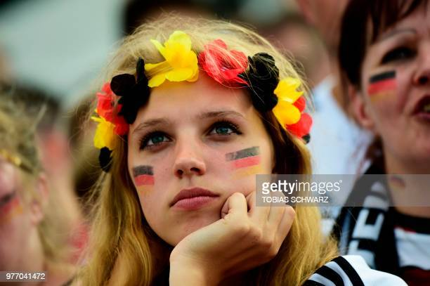 A fan of the German team wearing colors of the German national flag watches the Russia 2018 World Cup Group F football match between Germany and...