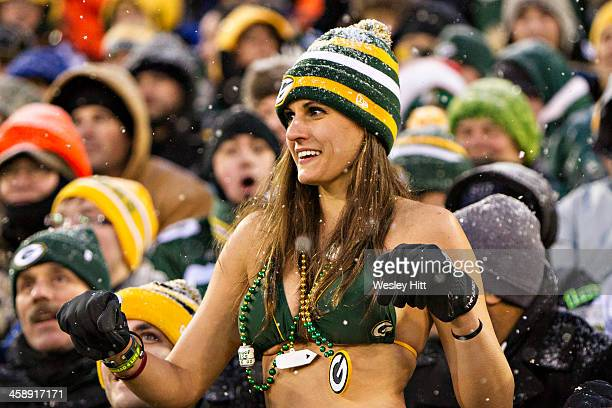 Fan of the Green Bay Packers dances in the snow in her bathing suit during a game against the Pittsburgh Steelers at Lambeau Field on December 22...