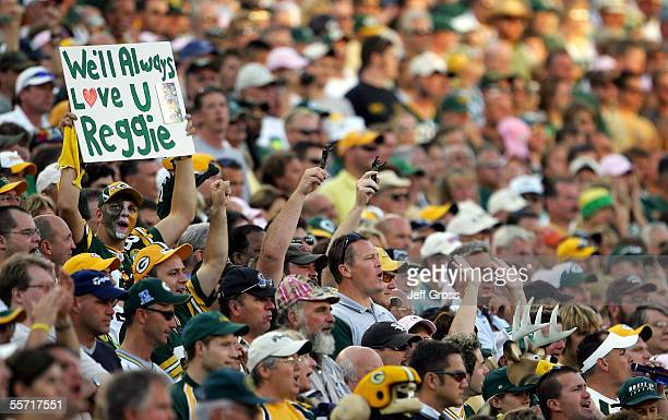 A fan of the Green Bay Packers holds up a sign honoring the late Reggie White whose number '92' was retired during a half time ceremony in a game...