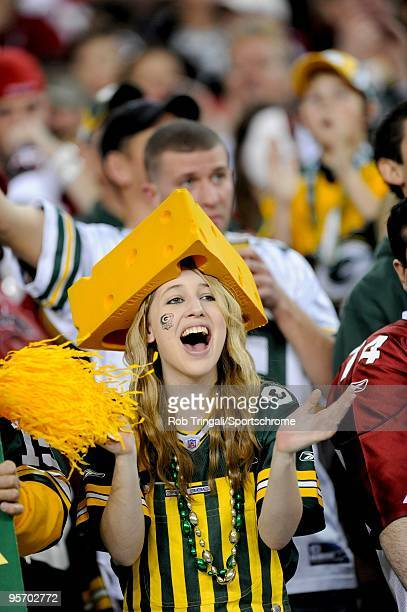 Fan of the Green Bay Packers with a cheese head cheers against the Arizona Cardinals in the NFC wild-card playoff game at University of Phoenix...