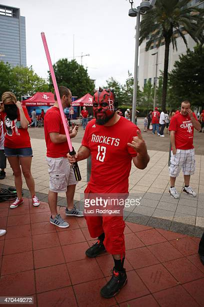 A fan of the Houston Rockets poses for a photo before a game against the Dallas Mavericks in Game One of the Western Conference Quarterfinals during...
