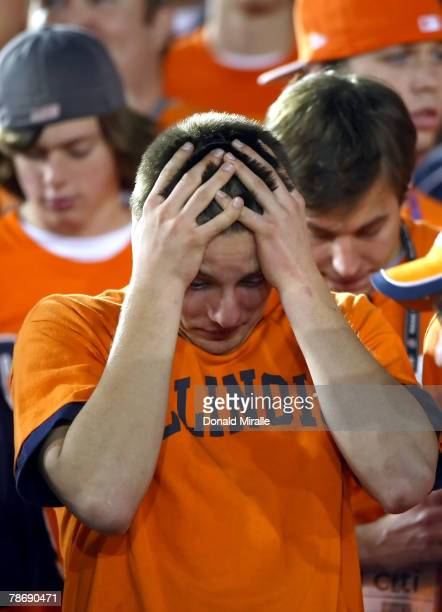 """Fan of the Illinois Fighting Illini holds his head down late in the fourth quarter against the USC Trojans in the """"Rose Bowl presented by Citi"""" at..."""