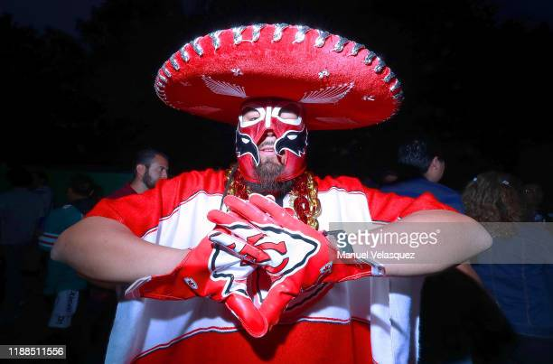 A fan of the Kansas City Chiefs poses for photos before the game against the Los Angeles Chargers at Estadio Azteca on November 18 2019 in Mexico...