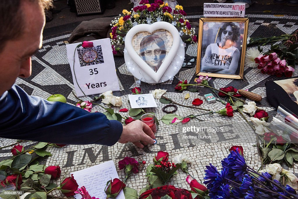 A fan of the late John Lennon places a pin a top the 'Strawberry Fields' tile mosaic in Central Park, which was created in tribute to the musician, to mark the 35-year anniversary of his death on December 8, 2015 in New York City. Lennon was shot and killed by a gunman outside his apartment in the nearby Dakota building.