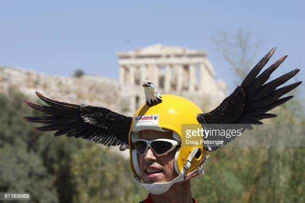 Fan of the men's cycling road race watches under the temple of Parthenon atop the Acropolis on August 14, 2004 during the Athens 2004 Summer Olympic...