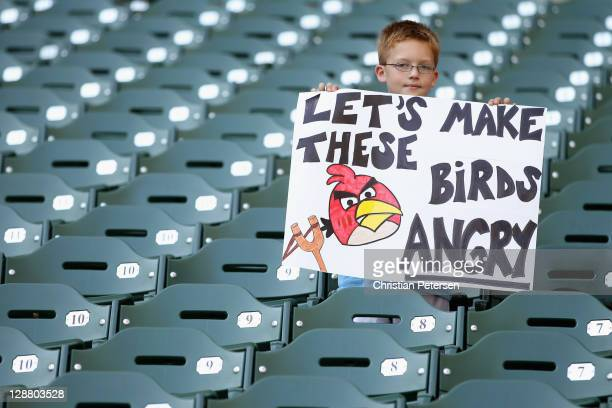 A fan of the Milwaukee Brewers holds up a sign which reads 'Let's make these birds angry' prior to the Brewers hosting the St Louis Cardinals during...