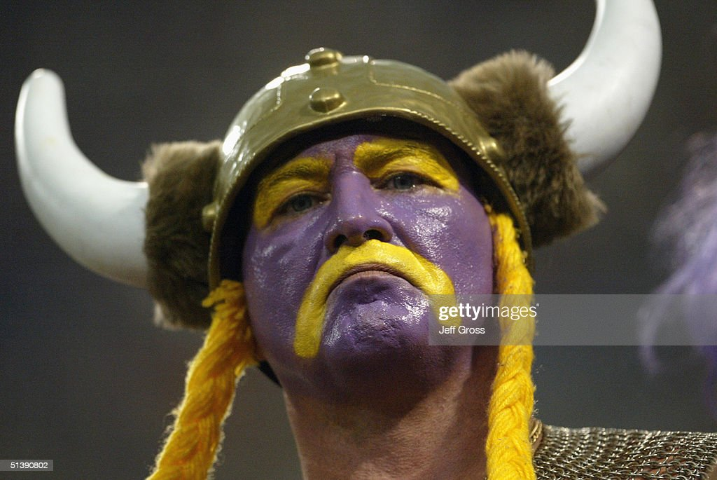 A Fan Of The Minnesota Vikings Wears Face Paint And A Viking Hat