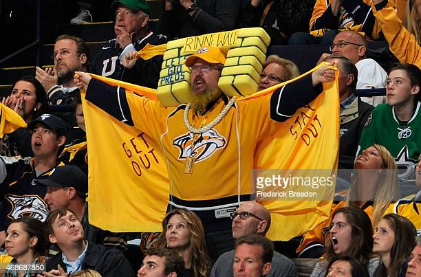 A fan of the Nashville Predators cheers during the third period of a game against of the Dallas Stars at Bridgestone Arena on April 4 2015 in...