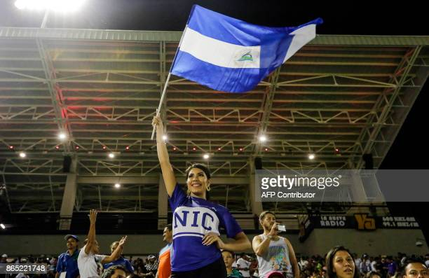 A fan of the National Baseball Team of Nicaragua celebrates after National Baseball team of Nicaragua defeate the National Selection of Baseball of...