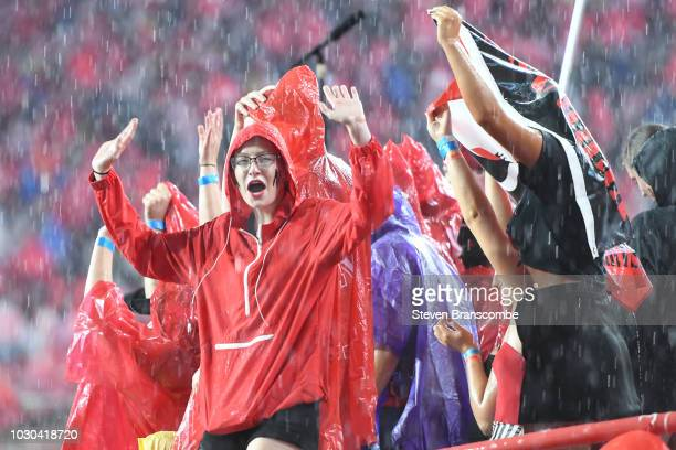A fan of the Nebraska Cornhuskers waits out a weather delay in the game against the Akron Zips at Memorial Stadium on September 1 2018 in Lincoln...