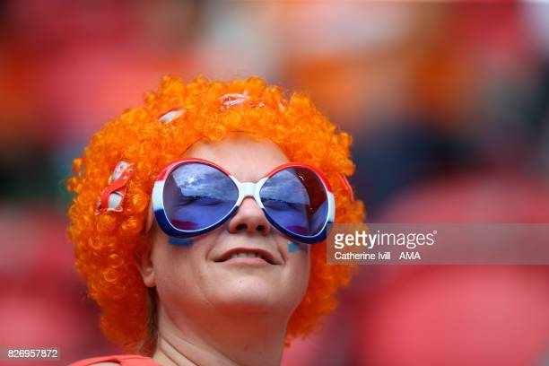 A fan of the Netherlands wearing a wig and funny glasses before the UEFA Women's Euro 2017 final match between Denmark and Netherlands at De Grolsch...