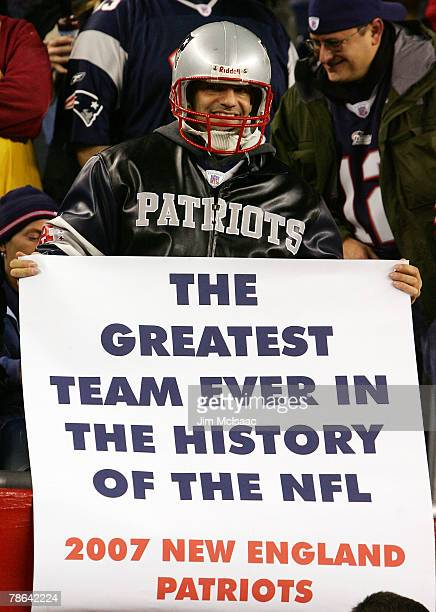 A fan of the New England Patriots holds up a banner during their game against the Miami Dolphins at Gillette Stadium on December 23 2007 in Foxboro...