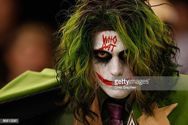 A fan of the New Orleans Saints dressed as 'The Joker' poses during the game against the Dallas Cowboys at the Louisiana Superdome on December 19...