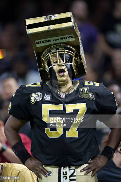 Fan of the New Orleans Saints yells for his team during a preseason game against the Baltimore Ravens at MercedesBenz Superdome on August 31 2017 in...